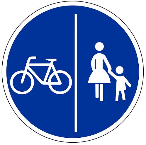 Bildbeschreibung: Auf Bild 7 sind auf dem runden Verkehrszeichen weiß auf blau, links ein Fahrrad und rechts eine Frau mit einem Kind (entsprechend Zeichen 239) abgebildet. Beide Symbole sind durch einen senkrecht verlaufenden Strich getrennt. Ende der Bildbeschreibung.